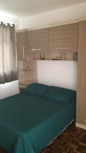 A bed or beds in a room at Minha Casa em Curitiba