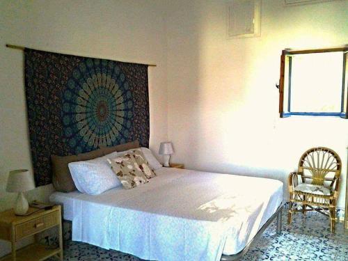 Uma cama ou camas num quarto em Casa Iditella