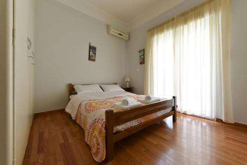 Ein Bett oder Betten in einem Zimmer der Unterkunft Victoria Square Apartment Apts