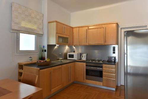 Küche/Küchenzeile in der Unterkunft Victoria Square Apartment Apts