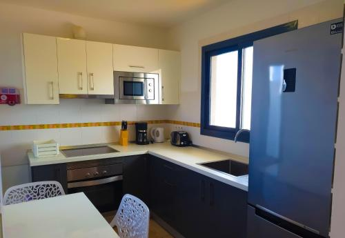 A kitchen or kitchenette at Prime Villas Lanzarote