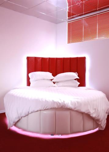 Кровать или кровати в номере Бутик-отель Истории