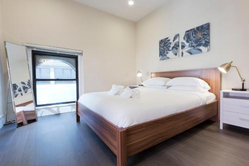 A bed or beds in a room at Sonder — Winthrop Square