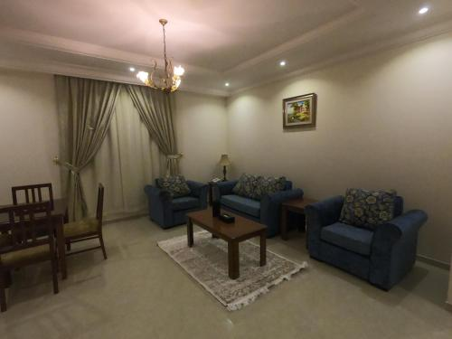 A seating area at Aknan Al Wed Furnished Units