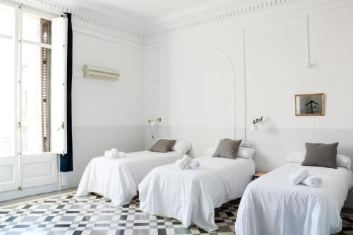 A bed or beds in a room at My Address in Barcelona