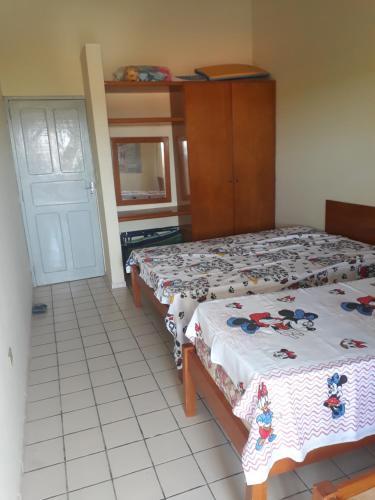 Cama ou camas em um quarto em Casa com piscina em Itamaracá
