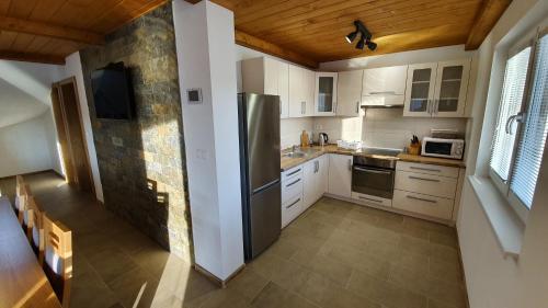 Kuchyň nebo kuchyňský kout v ubytování Chaty Krušetnica