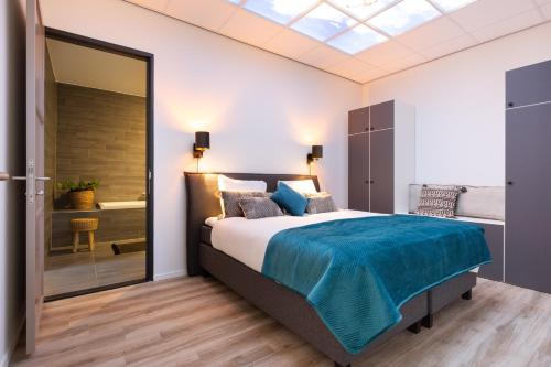 A bed or beds in a room at BizStay Harbour Scheveningen Apartments