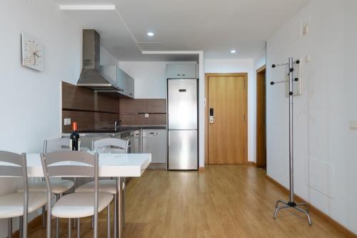 Majoituspaikan Apartamentos Atlantis Canarias Getaway keittiö tai keittotila