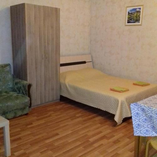 A bed or beds in a room at Guest House on Pyatigorskaya Street
