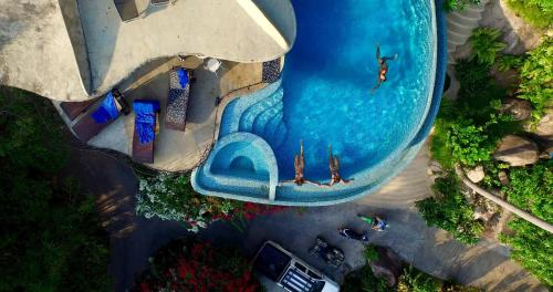 A view of the pool at Monkey Flower Villas or nearby