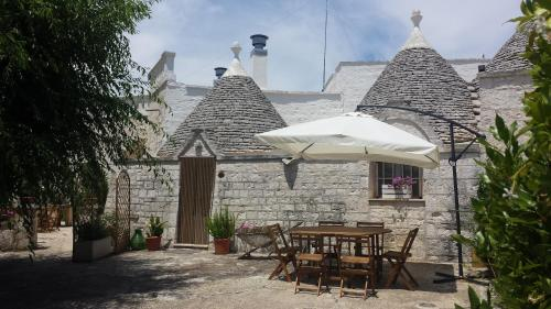 A porch or other outdoor area at Trulli di Rosa
