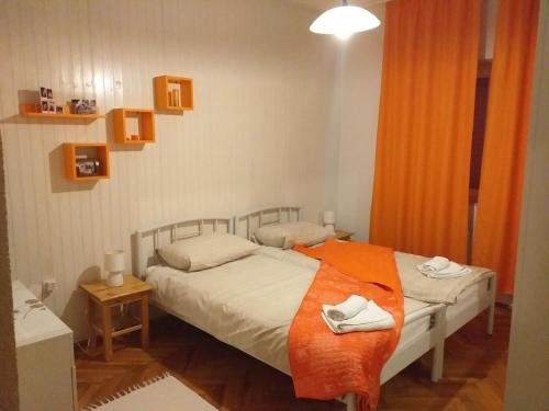 A bed or beds in a room at Apartments Duras