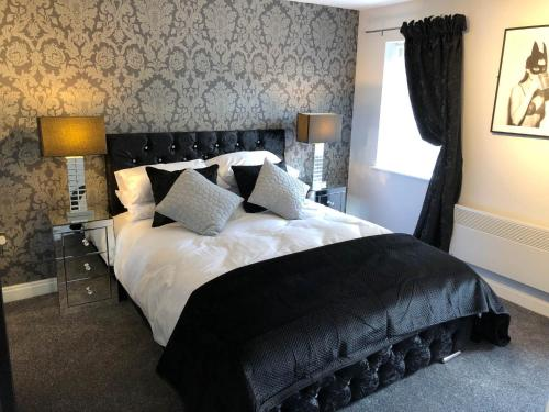 A bed or beds in a room at The Place Blackpool