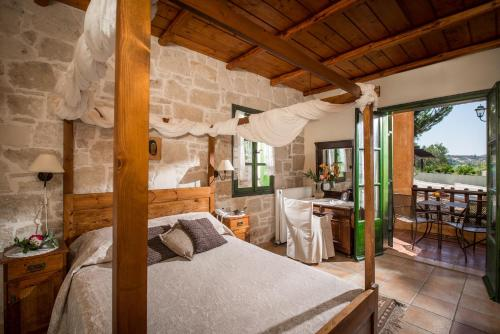A bed or beds in a room at Enagron Ecotourism Village