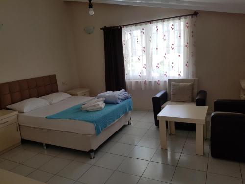 Кровать или кровати в номере Kara Family Apart