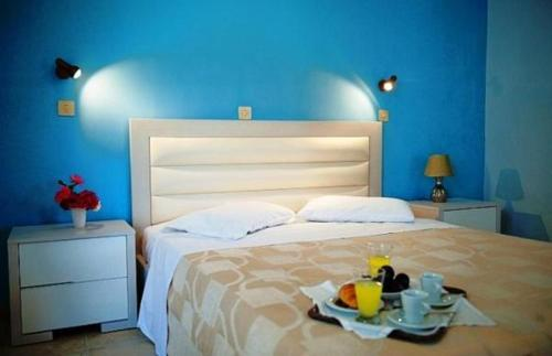 A bed or beds in a room at Elea Hotel Apartments and Villas