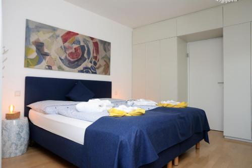 A bed or beds in a room at Seeappartement Marina