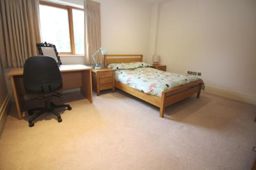 A bed or beds in a room at Big Fish - The Pines - Belfast Luxury