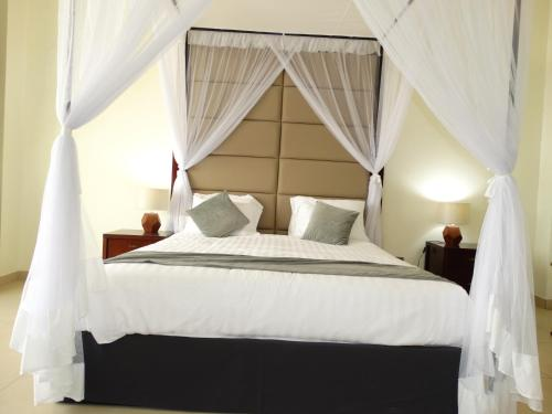 A bed or beds in a room at Nyali Golf View Residence