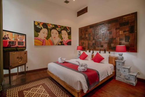 A bed or beds in a room at The Secret Jungle Villas by Premier Hospitality Asia