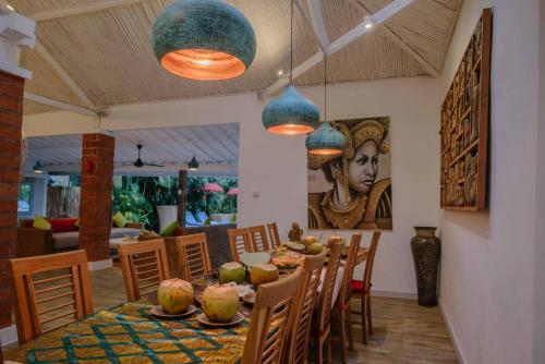 A restaurant or other place to eat at The Secret Jungle Villas by Premier Hospitality Asia