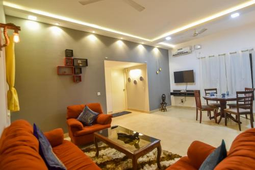 A seating area at EKO STAY- SIGNATURE APARTMENT