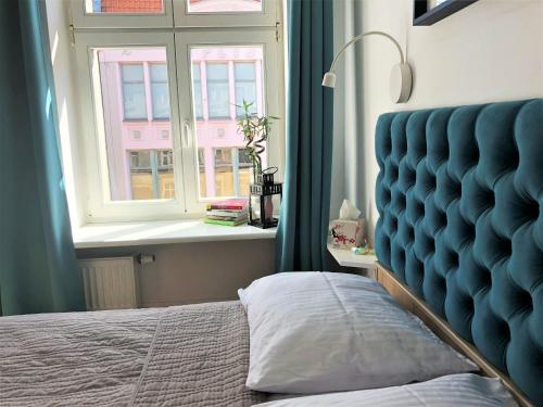 A bed or beds in a room at Apartament na Szczytnej - free PARKING
