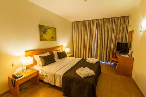 A bed or beds in a room at Eurosol Residence