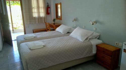 A bed or beds in a room at Kamelia