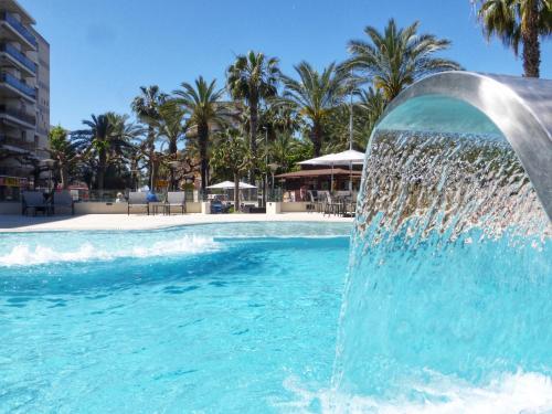 The swimming pool at or near Rentalmar Los Peces