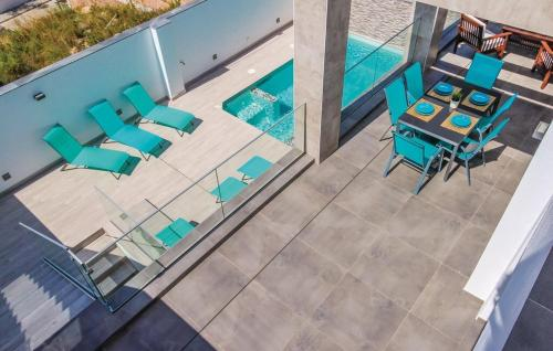 A view of the pool at Villa Manhattan or nearby