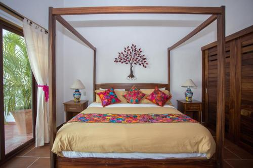 A bed or beds in a room at Refugio del Mar