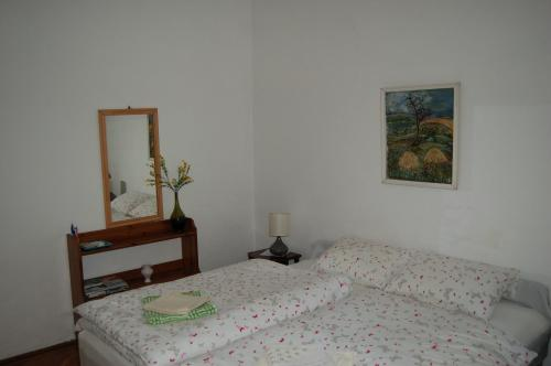 A bed or beds in a room at Buda Castle Apartments