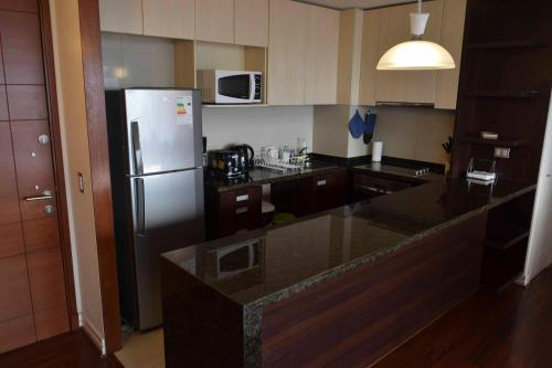 Una cocina o zona de cocina en Kennedy Premium Apartments
