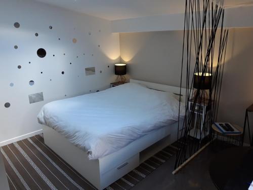Postel nebo postele na pokoji v ubytování STUDIO LE CHOUETTE