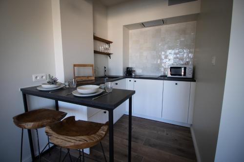 Küche/Küchenzeile in der Unterkunft studio Modine