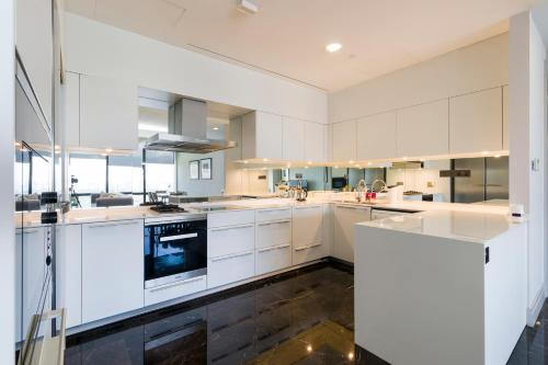 A kitchen or kitchenette at KL Central Luxury Apartment by GuestReady