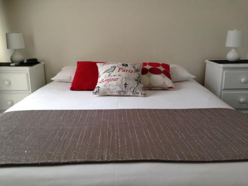 A bed or beds in a room at Accommodation Portland Victoria