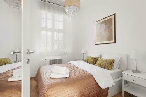 Łóżko lub łóżka w pokoju w obiekcie VIU Postcards from Gdansk