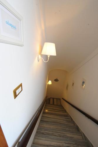 Posteľ alebo postele v izbe v ubytovaní Aduepassi