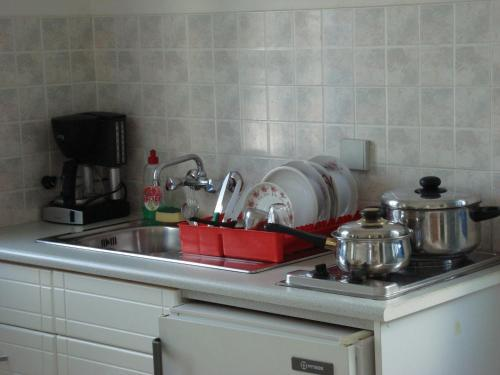 A kitchen or kitchenette at Creta Sun Hotel Studios