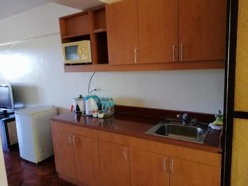 A kitchen or kitchenette at Kiera 208 Alta Vista Boracay