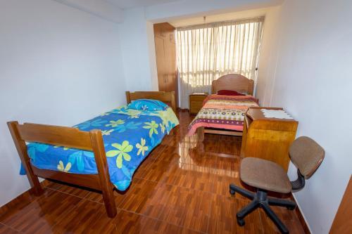 Giường trong phòng chung tại Inti house