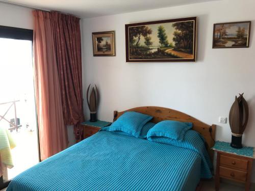 Una cama o camas en una habitación de Holiday Home Bungamar