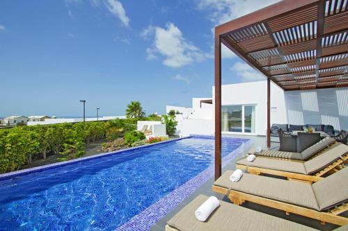 Het zwembad bij of vlak bij Villas Hoopoe Lanzarote Playa Blanca - ACE03058-OYB