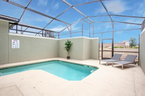The swimming pool at or close to Splendid Four Bedroom Close To Disney w/ Pool 4987