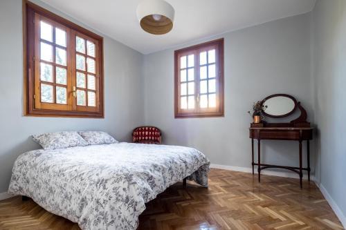 A bed or beds in a room at Acogedor chalet en Retiro