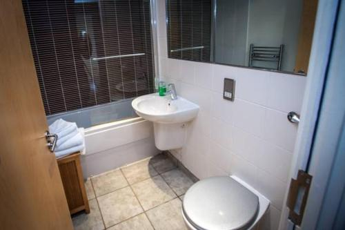A bathroom at Cranbrook House Apartments - Near Ice Arena