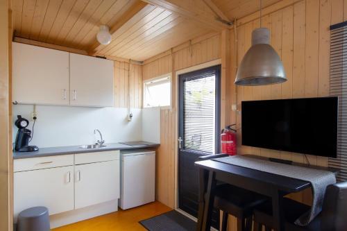 A cozinha ou cozinha compacta de Centre beach lodge